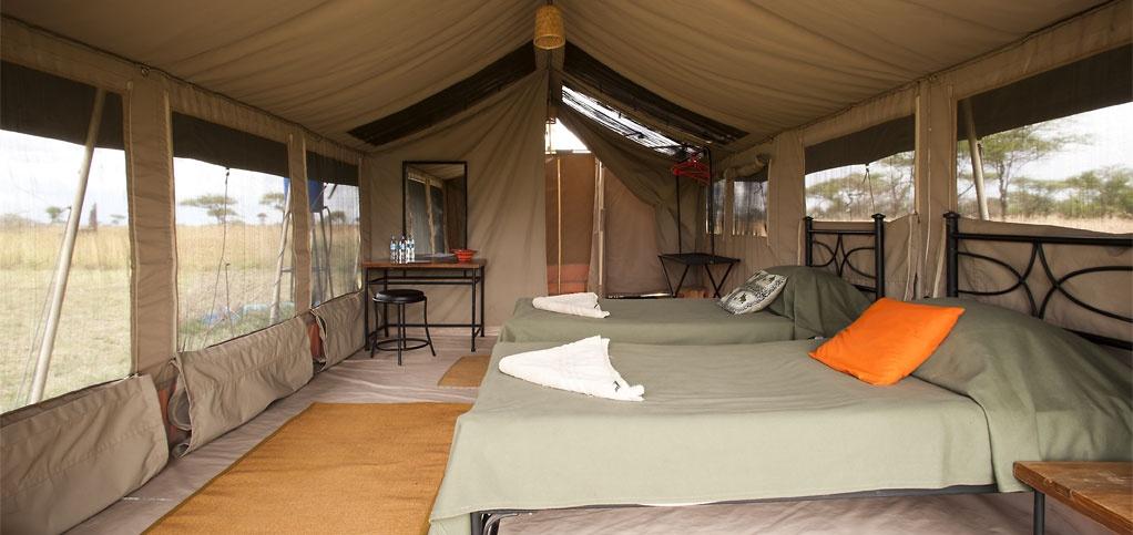 A bedroom at Kati Kati C& & Kati Kati Camp  Tanzania Serengeti National Park Tanzania