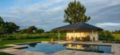 The outdoor dining and pool area
