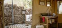 Each tent has an outdoor bucket shower - true safari style!
